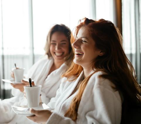 women in robes enjoying relation time