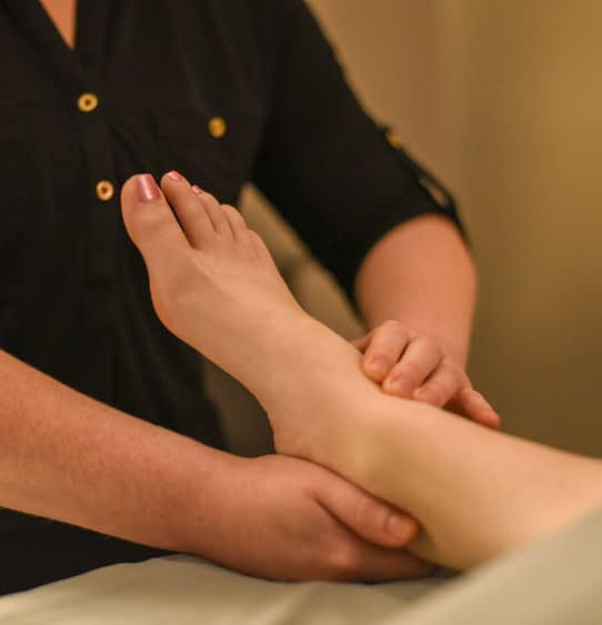 Woman getting ankle massage