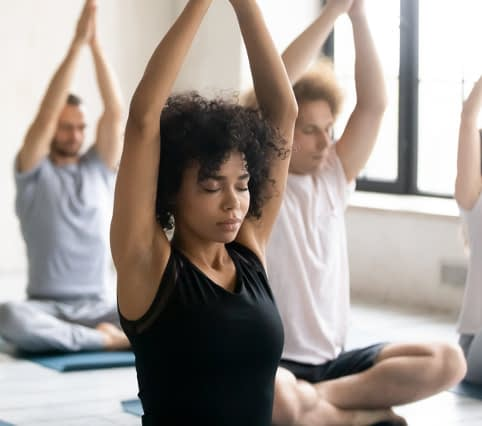Women and men doing yoga
